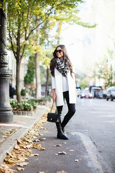 Kat Tanita of With Love From Kat wears a chic cream Harlowe and Graham topper coat with a grey sweater, black jeans and over the knee boots.