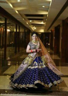 Looking for Navy blue bridal lehenga offbeat? Browse of latest bridal photos, lehenga & jewelry designs, decor ideas, etc. Wedding Lehnga, Indian Bridal Lehenga, Indian Bridal Outfits, Indian Bridal Fashion, Indian Bridal Wear, Indian Dresses, Eid Dresses, Wedding Updo, Bridal Lehenga Collection