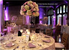 A luscious reception design with draping crystals, pastel flowers, and cool colored lighting.
