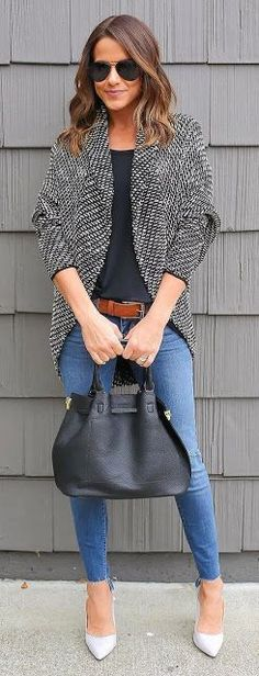 Oversized gray sweater, navy top, skinniest with brown belt and gray heels.