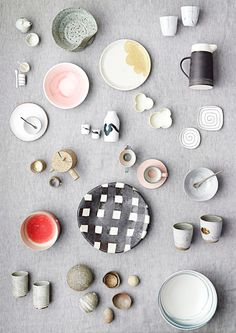 ceramics in a style I love but don't know the word for. Stark? Simple? Clean? Splayed? Really like it.