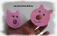 Mahé (10mois) et Maissa (28mois) ont peint un petit bout de carton, en rose.  Puis Tatie a découpé une tête de cochon, et un trou pour y glisser un petit doigt, pour faire le groin.