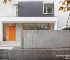 Modern textures on exterior--corrugated metals, wood, and concrete