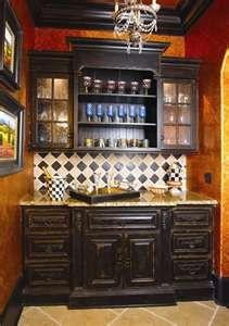 black cabinets+ harlequin pattern tile =nice butler's pantry