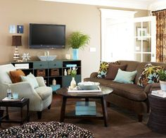 Living Room - Brown couch, beige walls, blue and green decor. Love this colour combination.