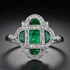 This darling and diminutive early-Art Deco delight - circa 1920 - glistens with a bright green central emerald-cut emerald and four half-moon emeralds lovingly framed in platinum and teeny-tiny rose-cut diamonds. An original and dreamy Art Deco ring. Anel Art Deco, Bijoux Art Deco, Art Deco Ring, Art Deco Jewelry, Jewelry Design, I Love Jewelry, Jewelry Rings, Jewelry Accessories, Fine Jewelry