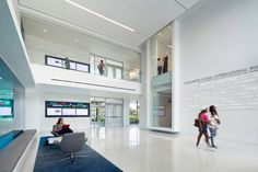As students pass through the lobby, extra space is used to support quick meetings in the Lynn University Mohammed Indimi International Business Center