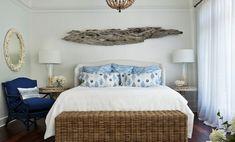 Beach house bedroom with coastal slipcover headboard