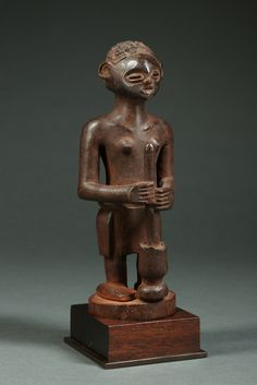 """Rare Chokwe Shrine Figure with Mortar and Exceptional Coiffure Culture; Chokwe, Angola, circa 1890-1920 wood (one piece), stainDimensions: 10.5"""" (26.67 cm) h"""