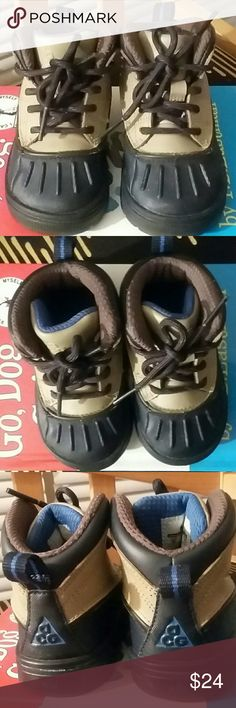 Infant Boy's Nike AVG Boots Excellent used condition.Tan around the top half,navy blue around the bottom.Shoelaces have both tips and bottom has no scuffs.Perfect for jumping in fall leaves and withstanding the winter weather. Nike ACG Shoes Baby & Walker