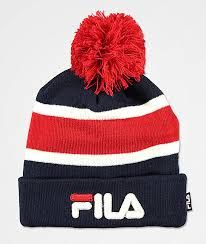premium selection 07a27 4ad02 Cozy up without compromising your athletic styles in the Heritage Peacoat  Pom Beanie from FILA. This beanie features a ribbed knit construction in a  red, ...