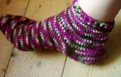 I learnt to crochet socks a couple of months ago - here are a few of my finished ones. I use a toe up pattern with a short row heel, so there are no seams to sew and just two ends to weave in at the end. They work up fast and are very portable - I don't need stitch markers or a tape measure (just try them on as I go) so just need yarn and hook! I make them in half treble crochet (UK terminology) so that they are nice and stretchy. I actually prefer them to my knit socks.