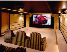 Warm theater design with decorative wall panels & seating