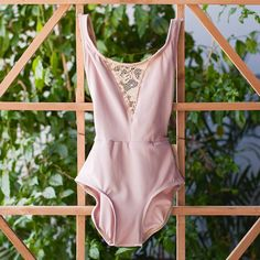 DART style is the dancer's dream leotard. Lace v-neck front with a back lace scoop accent.