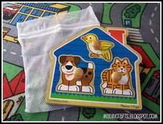 Mesh bags from the dollar store for puzzles and toys