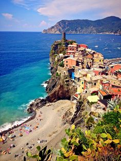 In the traffic-free Cinque Terre, a remote chunk of the Italian Riviera, there's not a museum in sight — just sun, sea, sand (well, pebbles), wine, and pure, unadulterated Italy. Enjoy the villages, swimming, hiking, and evening romance of one of God's great gifts to tourism. For a home base, choose among five (cinque) villages, each of which fills a ravine with a lazy hive of human activity — calloused locals, sunburned travelers, and no Vespas.