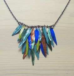 Wire and nail polish feather necklace