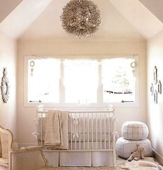 neutral nursery | pendant light & poofs