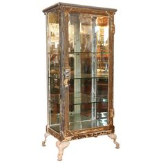 Antique Metal and Glass Cabinets | Antique stripped metal and glass medical cabinet