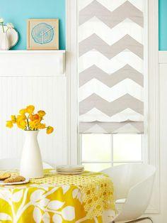 Paint/stencil on a plain white roman shade to create a custom window treatment.