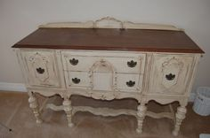 old style class sideboard with French detailing and elaborate long legs