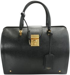 GB1072151 - CP Thom Browne Pebbled Leather Mr. Thom Bag Pebbled Leather Mr. Thom Bag from Thom Browne featuring round top handles, a hanging leather tag, a foldover top, a push lock fastening, a zip fastening, gold-tone hardware, an internal zipped pocket, an internal logo patch, a striped lining and a tricolour grosgrain tab. Made in Italy This item shows signs of pre-owned wear: minor surface scratches on hardware, missing detachable strap. Original box and dust bag not included. *Please see p Black Leather Satchel, Leather Clutch, Pebbled Leather, Round Top, Types Of Bag, Thom Browne, Hermes Birkin, Plexus Products, Bootie Boots