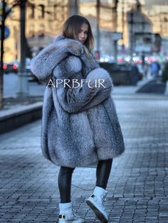 Fur coat A figurative cut with natural fur bluefrost