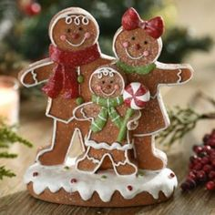 Baking gingerbread men and building gingerbread houses are fun holiday traditions. Keep them around a little longer with Kirkland's Glittered Gingerbread Family Statue. Including a mom, dad and child, this family is as jolly as can be! Christmas Makes, Noel Christmas, Christmas Goodies, Christmas Candy, All Things Christmas, Holiday Fun, Christmas Crafts, Christmas Ornaments, Italian Christmas