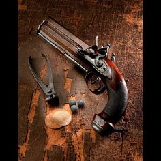 A very rare Westley Richards 16g over and under flintlock pistol- old scoool classic