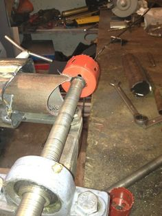 Tubing Notcher by Steinbruchsoldat -- Homemade tubing notcher constructed from surplus steel rod, pillow bearings, and a hole saw. http://www.homemadetools.net/homemade-tubing-notcher-6