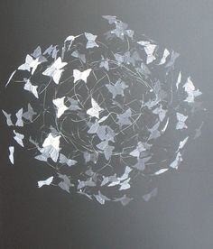 White Butterfly Mobile, an orb shaped mobile for a nursery or bedroom decor. Gracefully moves with a calming serene effect for all who observe the