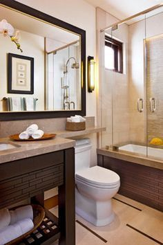 Smart idea for basement bathroom - extend counter top over sink and continue vanity on other side!