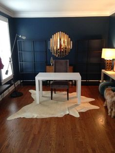 ... Benjamin Moore's Gentleman's Gray. I must say, it looks amazing. While the room is not done yet (still needs some more furniture, lighting, accessories, ...