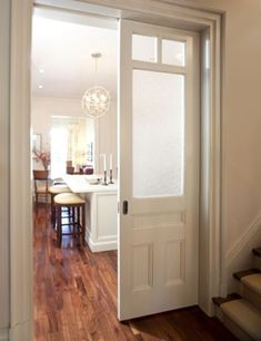 pair of pocket doors with frosted glass windows master closet