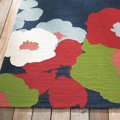 Blooming beautiful, our hand-hooked Lillian Outdoor Rug is wonderfully soft    underfoot. While you're admiring the bold, ruggedly chic aesthetic of    modern graphic flowers strewn at your feet, make sure your sandals are off    too, so you can savor the softness of the texture. Best of all, this style    is made of stain- and dirt-resistant, quick-drying polypropylene fibers. No    worries while you party the summer away poolside with your happy barefoot    friends. It's made d...