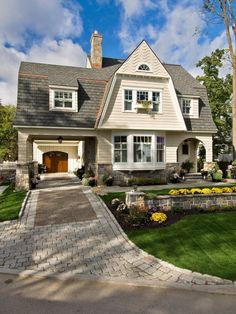 Charming home by Witt Construction - love the drive thru to the garage at the back