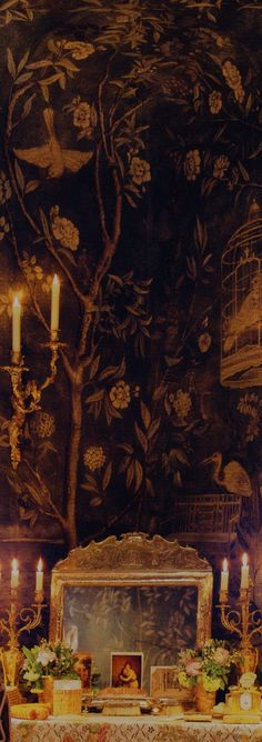 Chinoiserie-Wallpaper-golden-mirror-and-candlelight. Anne Frederick explores the art of water-gilding - an ancient technique of treating wood with gold leaf and burnishing it to a high gloss so it would throw and catch light in dimly lit rooms.