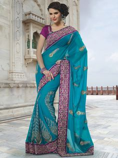 Celebrate this festive season with this viscos blue saree. The sari has gorgeous beads all over it and the magenta border with work all over adds a fancy look to the sari. The contrsating color is the highlight of this saree. (slight variation in color is possible)