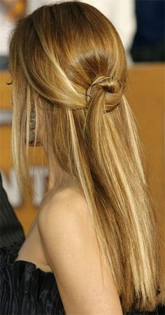 split your hair in half, take top portion and knot. pin the knotted part and leave the rest out. easy and chic!