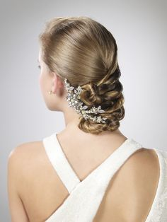 Clean and sleek updo - One sided Twists, pulled across and secured. Finished with large rhinestone clip.