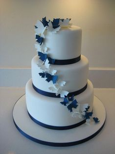 Navy and ivory butterfly wedding cake Navy Blue Wedding Cakes, Floral Wedding Cakes, Wedding Cake Rustic, Wedding Cakes With Cupcakes, Wedding Cake Decorations, Wedding Cakes With Flowers, Beautiful Wedding Cakes, Wedding Cake Designs, Wedding Cake Toppers