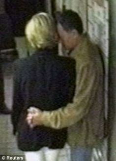 Princess Diana and Dodi al Fayed wait at the rear service exit of the Ritz Hotel in Paris on August 31, 1997