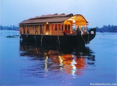 """houseboat or """"Kettuvallam"""" on the backwaters of Kerala, India. """"Beautifully fringed by the swaying coconut trees, the houseboat slowly floats over the backwaters, passing through rustic villages, terrific temples, exotic resorts, lush green paddy fields, scenic wonderments and panoramic sights that one can never forget."""" #India"""