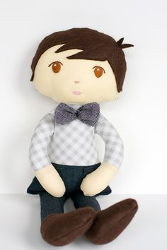I'm seeing a lot of gray baby nurseries - wouldn't this little boy doll be great in one? absolutely adorable! $38 from The Rice Babies on Etsy: http://www.etsy.com/listing/73328814/little-bow-tie-guy