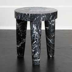 KELLY WEARSTLER | SMALL TRIBUTE STOOL. Hand-sculpted out of a solid block of Negro Marquina marble.