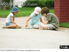 Children playing marbles in street [PAA373000002] > Stock Photos ...