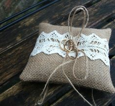 Hey, I found this really awesome Etsy listing at http://www.etsy.com/listing/121180251/burlap-rustic-ring-pillow-with-cream