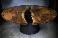 The Platte River dining table under painted light featuring a bronze hammered base What do you think of the smoky glass? Let me know in the comments!