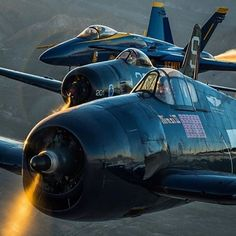 From front to back: F6F hellcat, F8F bearcat and a F/A -18