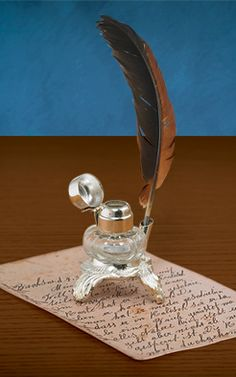 """Journals & Pens - Inkwell and Feather Pen —  """"Proclamations and poetry, love notes and letters from abroad - what might this pen and ink produce? Old-fashioned desktop inkwell and feather pen harken back through centuries of the written word. """""""
